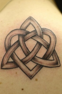 Celtic tracery tattoo on shoulder