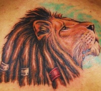 Lion of zion with dreads coloured tattoo