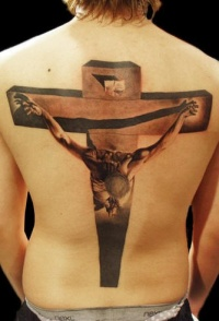 Realistic crucifixion tattoo on back